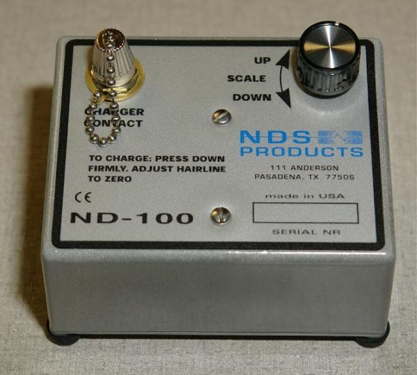 Model ND-100 portable battery powered dosimeter charger